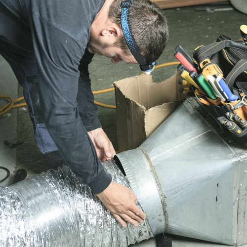 A Technician Attaches Ductwork.