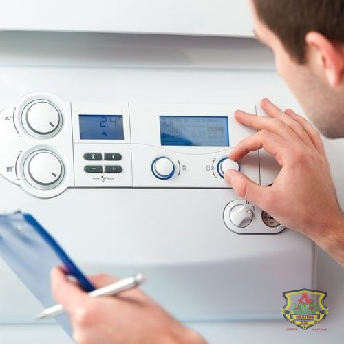 A Technician Tests a Boiler Control System